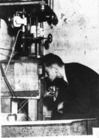 A. Soltan peering into a parraffin-lined Lauritsen electroscope