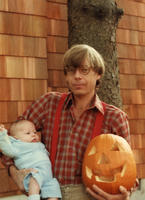 Dahlen holding baby and pumpkin