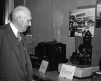 Charles Kettering viewing an early electric motor