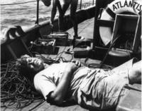 Ewing asleep on boat deck