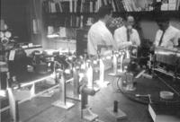 Alan White working with two unidentified men at Bell Laboratories