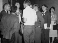 Milton Scheer, J. R. McNesby (talking), P. Goldfinger (short sleeves); G. Porter (hand on hip) and others unidentified