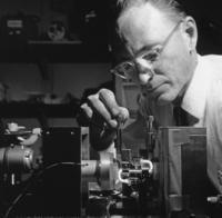 Alan White adjusts a new miniature helium-neon gas laser