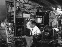 Alan White working in a laboratory on a helium neon laser